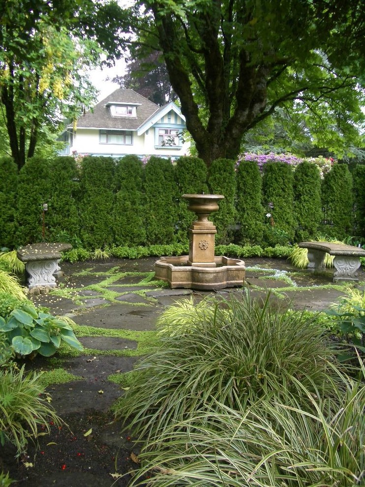 Design ideas for a traditional water fountain landscape in Vancouver.