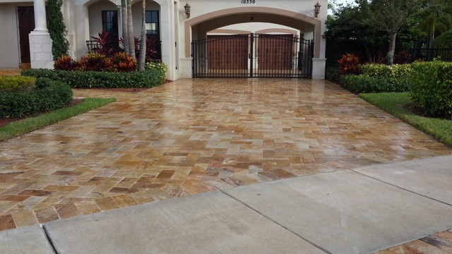 Travertine driveway sealed with cobble loc mediterranean for Bleaching concrete driveway