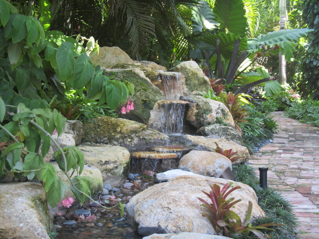Tropical Backyard Waterfall And Pond Traditional Landscape