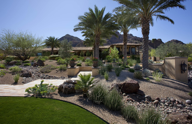 Desert Landscape Design Ideas this is an example of a mediterranean full sun backyard xeriscape in phoenix with mulch Photo Of An Expansive Southwestern Backyard Landscape In Phoenix With A Water Feature