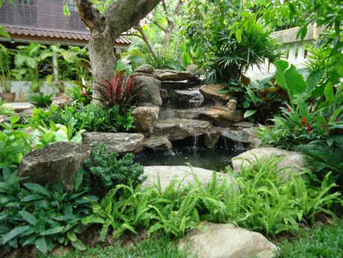 Tropical thailand waterfall garden tropical landscape for Artificial plants for outdoor ponds