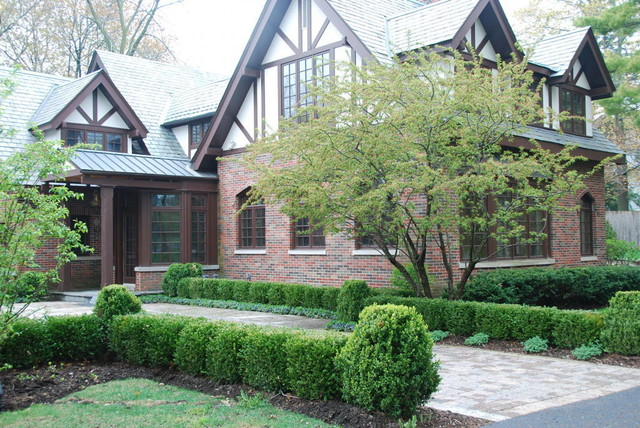 Tudor style traditional landscape chicago by for House architecture design garden advice