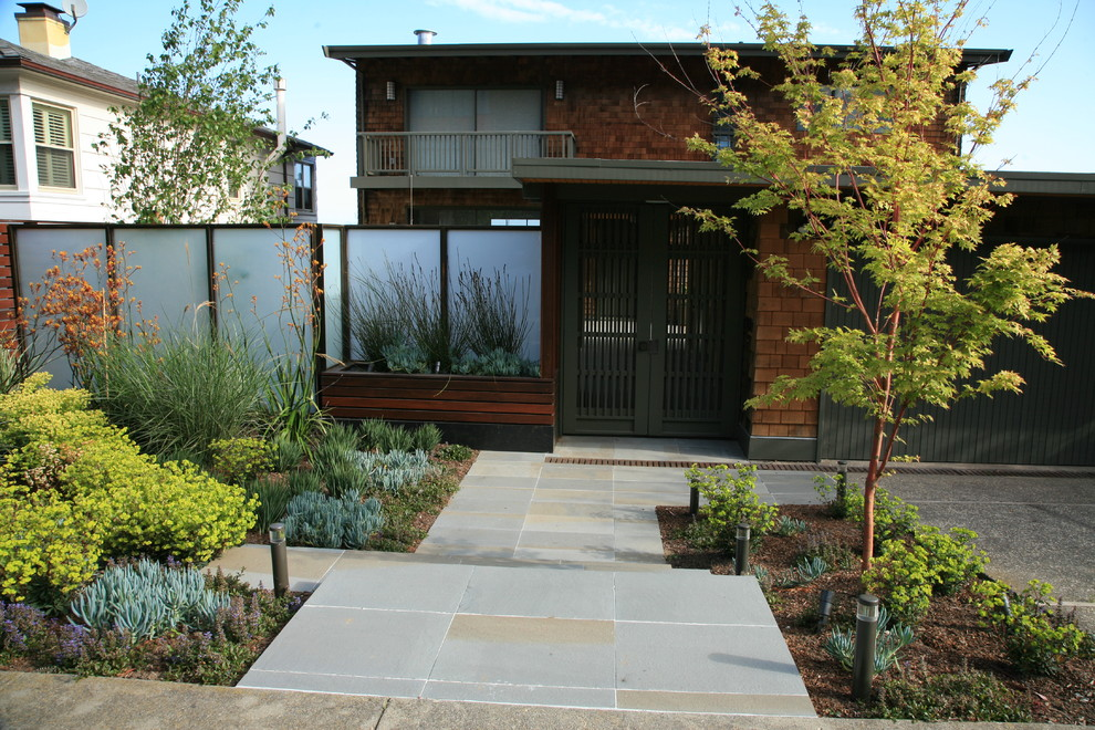 This is an example of a large modern drought-tolerant and partial sun front yard concrete paver garden path in San Francisco.
