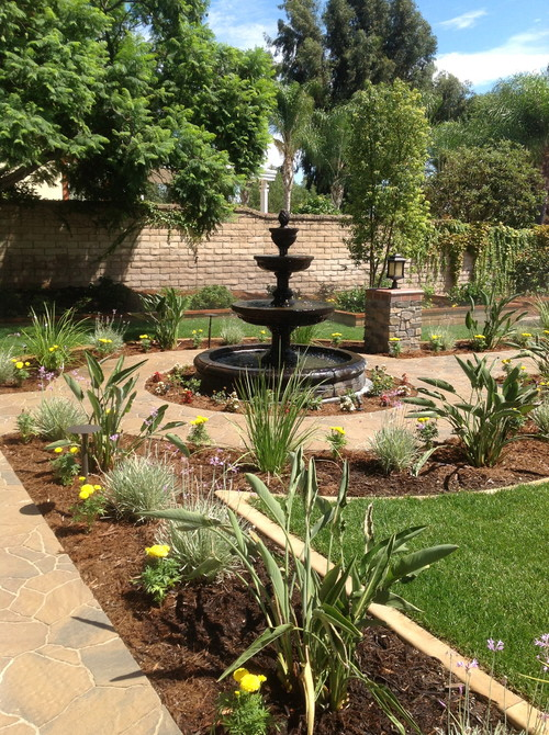 Traditional Landscape by Upland General Contractors Rob Clark Construction Inc.