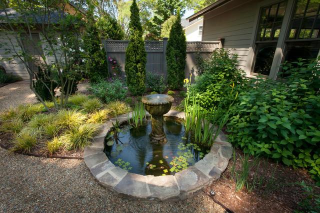 Urban gravel garden traditional landscape charlotte for Garden pond gravel