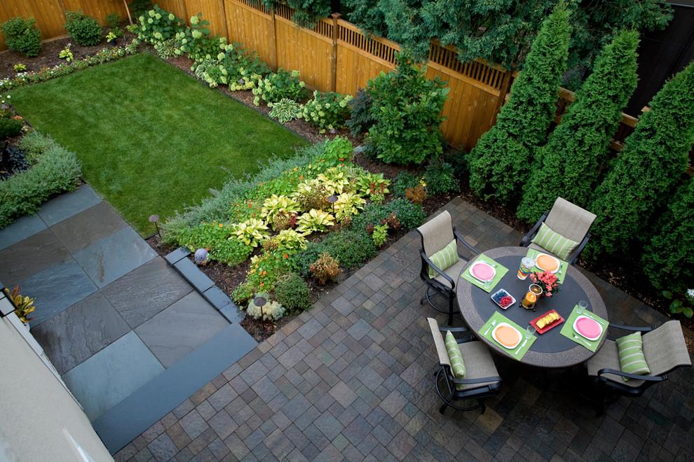 Design ideas for a traditional backyard stone vegetable garden landscape in Minneapolis.