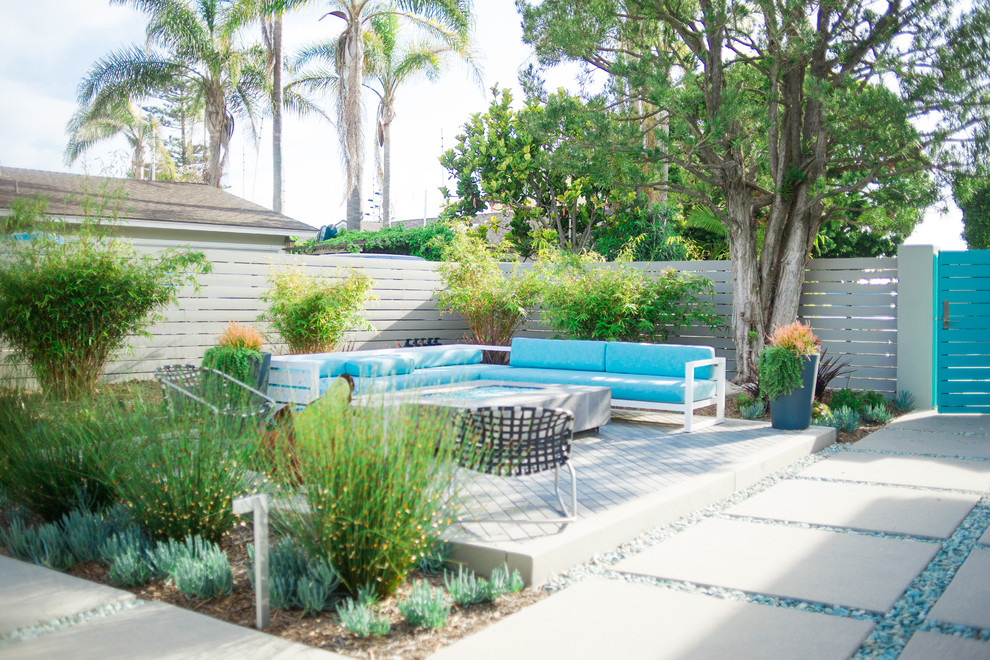 Design ideas for a large contemporary drought-tolerant and full sun backyard concrete paver landscaping in San Diego with a fire pit.