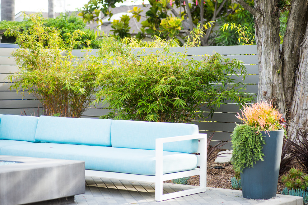 Inspiration for a contemporary drought-tolerant and full sun backyard concrete paver landscaping in San Diego with a fire pit.