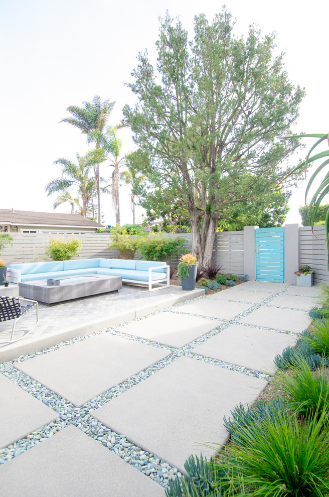 Inspiration for a large contemporary drought-tolerant and full sun backyard concrete paver landscaping in San Diego with a fire pit.