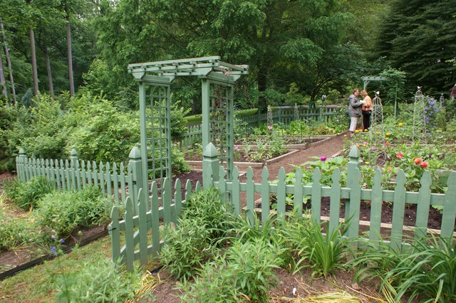 vegetable garden with a green picket fence