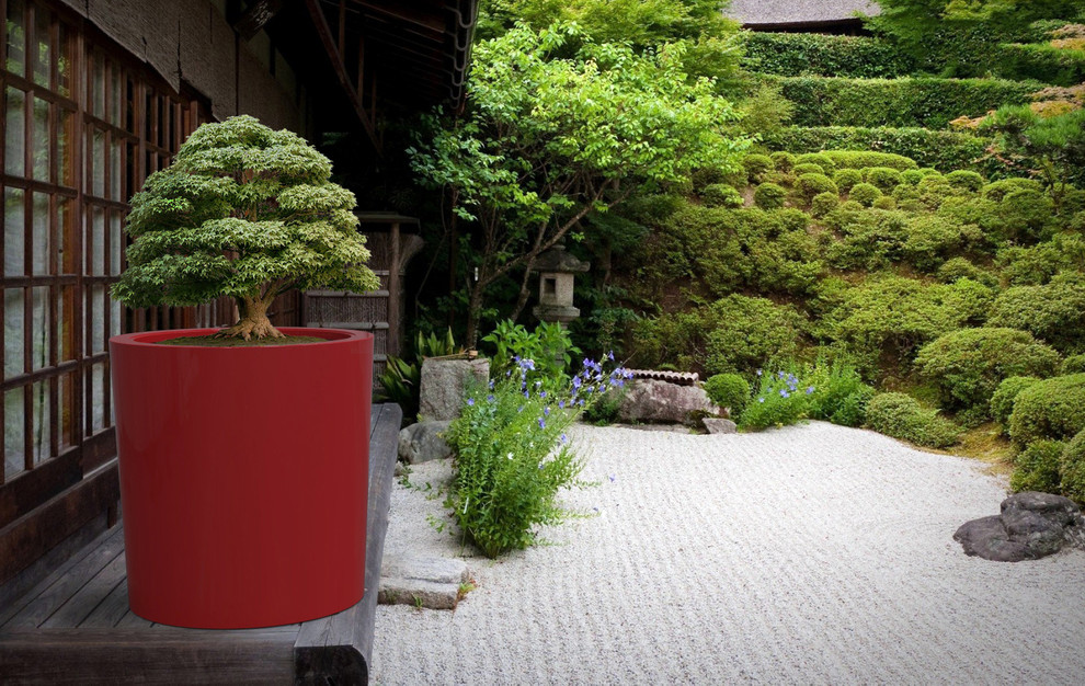This is an example of a large contemporary partial sun backyard concrete paver formal garden in Toronto for summer.