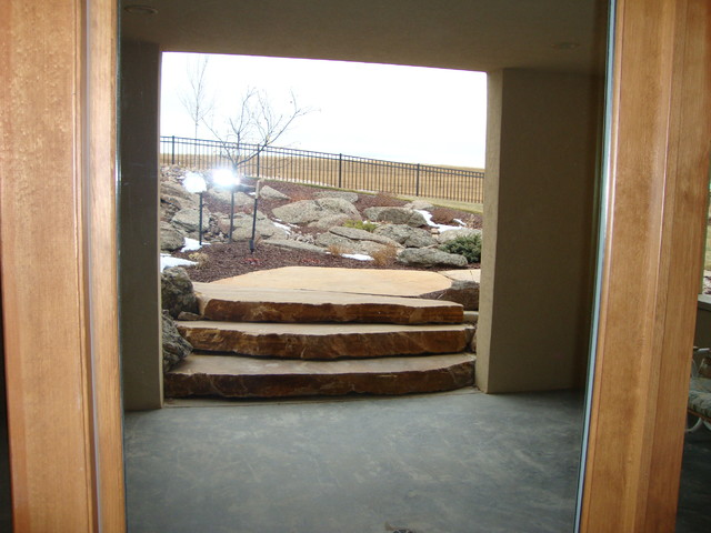 Walk Out Basement Entry From Water Feature Traditional