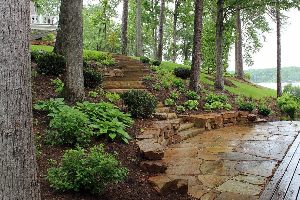 Design ideas for a mid-sized coastal partial sun hillside stone retaining wall landscape in DC Metro for spring.