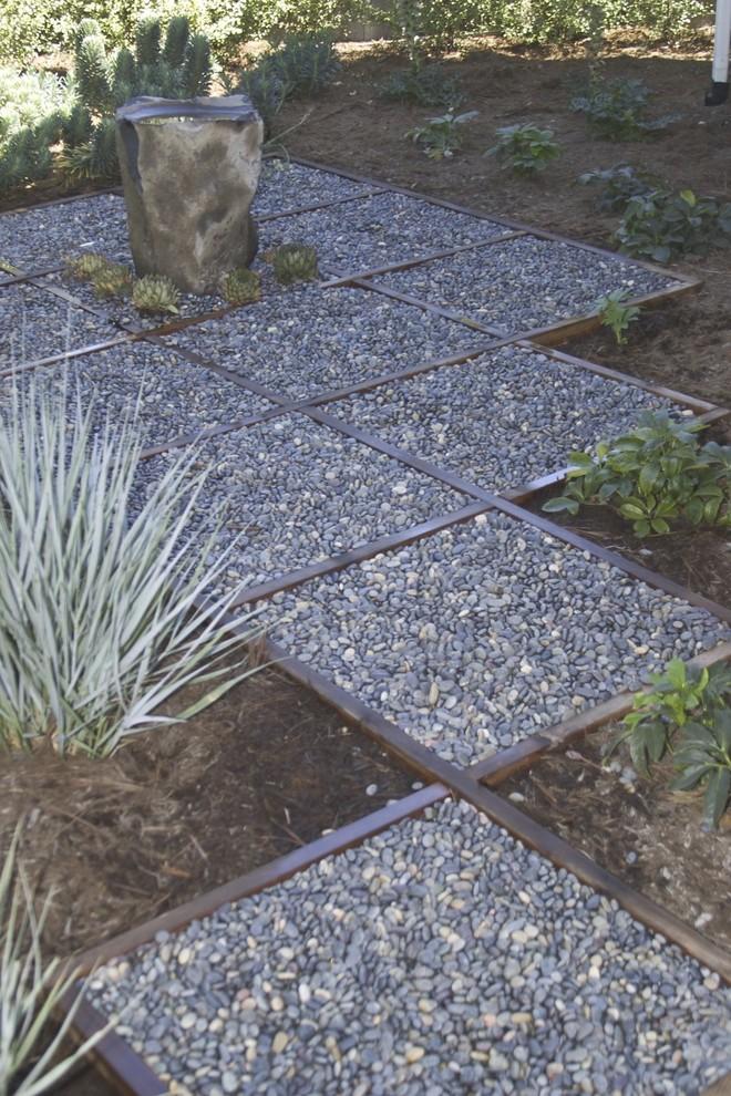 Photo of a contemporary backyard gravel landscaping in San Luis Obispo.
