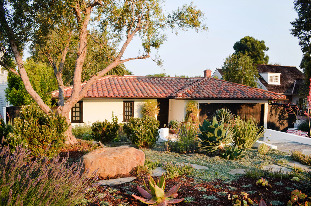Design ideas for a mid-sized mediterranean drought-tolerant and full sun front yard stone garden path in Los Angeles.