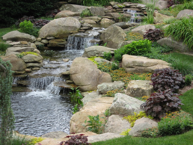 Waterfall and garden pond traditional landscape for Backyard pond ideas with waterfall