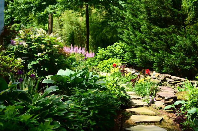 Waterfall koi pond oasis traditional garden dc for Pristine garden rooms
