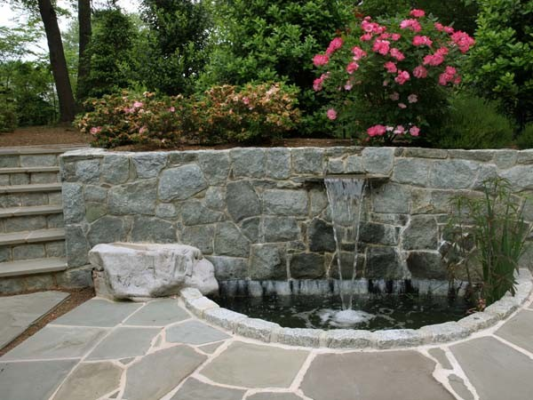 Waterfall stone wall and pond modern landscape for Modern pond waterfall