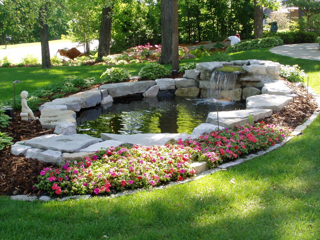 Waterfalls ponds traditional landscape minneapolis for Pond yard design