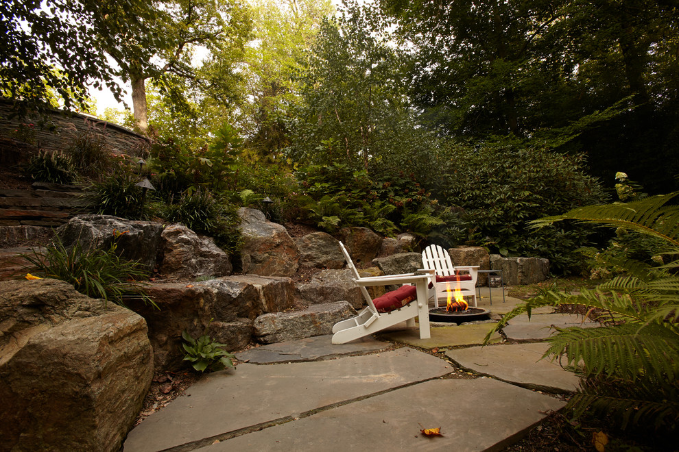 Design ideas for a large traditional shade and rock backyard stone formal garden in Philadelphia.