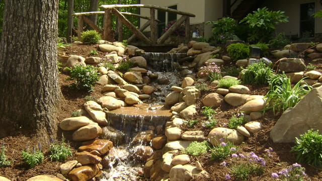 Weddington nc waterfall renovation rustic landscape for Rustic landscape ideas