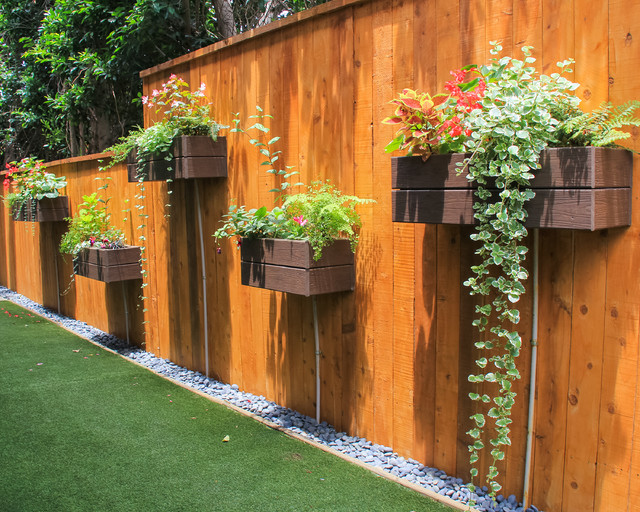 This is an example of a small eclectic partial sun backyard landscaping in Orange County for summer.