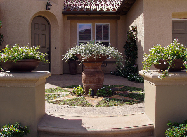 Welcoming Entryway With Pot Focal Point Mediterranean