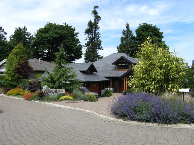 Design ideas for a large traditional front yard full sun driveway in  Vancouver with brick pavers - West Coast Contemporary Front Yard - Traditional - Garden