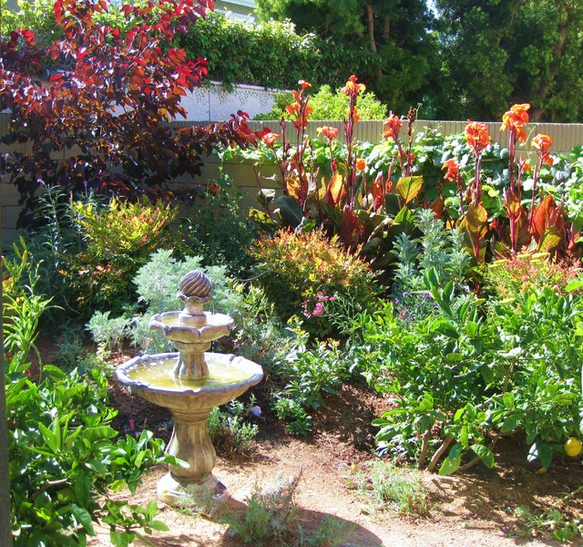 This Is An Example Of A Mid Sized Traditional Backyard Full Sun Garden In  Orange