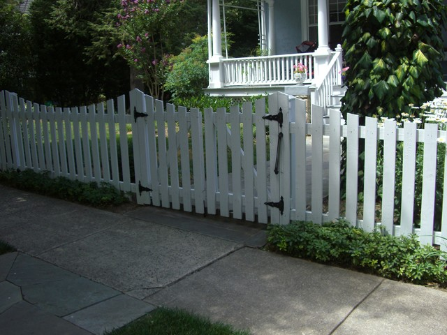 White picket fence and double gates contemporary