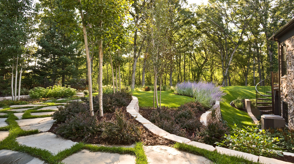 Design ideas for a contemporary retaining wall landscape in Minneapolis.