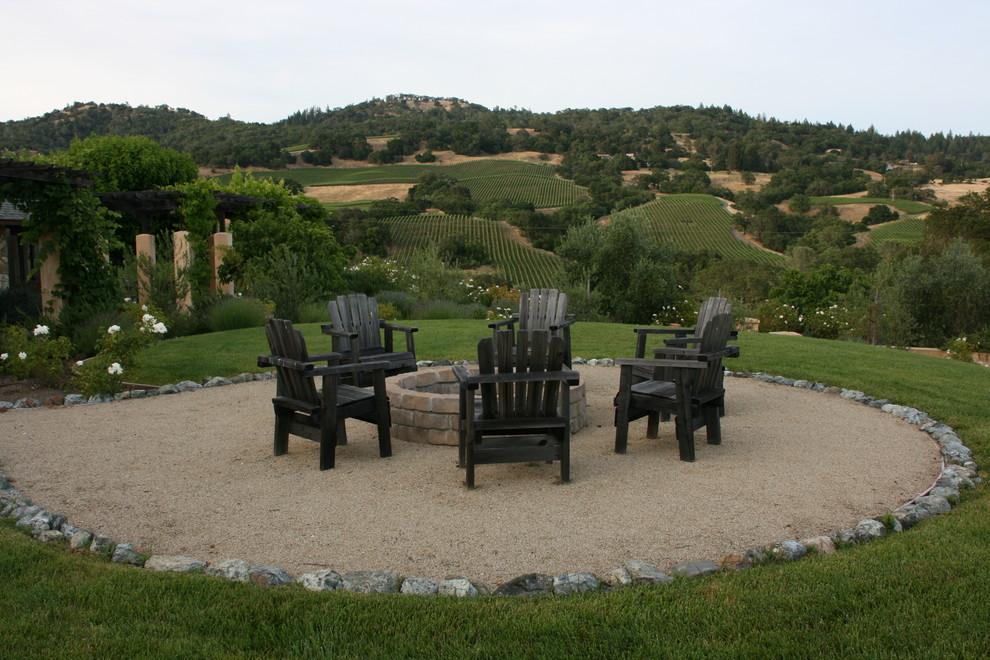 Photo of a mediterranean full sun backyard gravel landscaping in San Francisco.