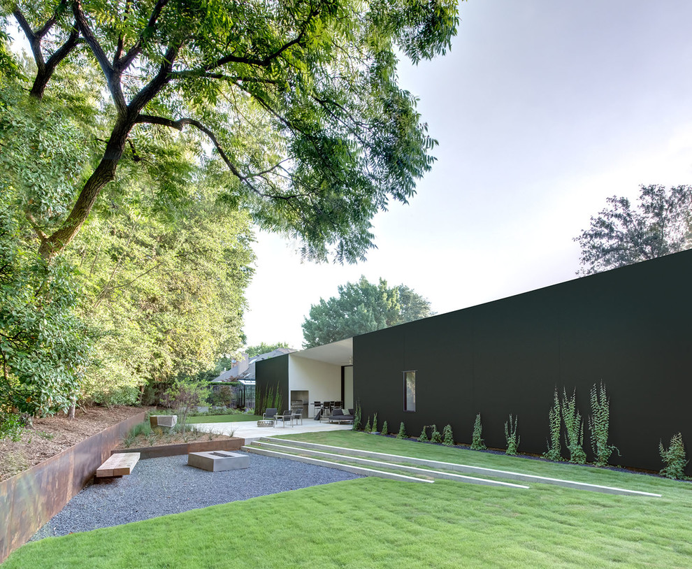 Inspiration for a contemporary backyard landscaping in Dallas with a fire pit.