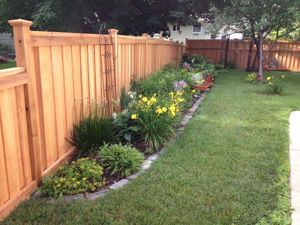Inspiration for a large transitional partial sun backyard mulch landscaping in Minneapolis.