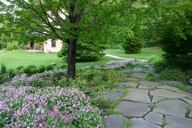 Inspiration for a mid-sized partial sun front yard stone garden path in Philadelphia for spring.