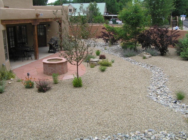 Xeriscape backyard w flagstone fire pit dry river bed for Landscaping rocks albuquerque