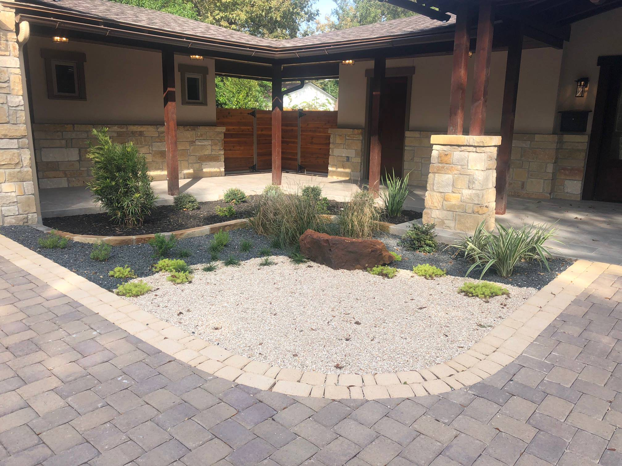 Xeriscape entryway using a combination of aggregates and mulch