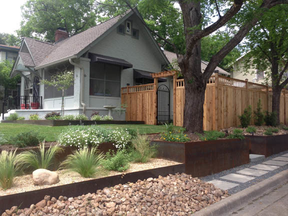 Xeriscape using Core-Ten retaining walls, Basalt pathways w/ stepping stones, Ne