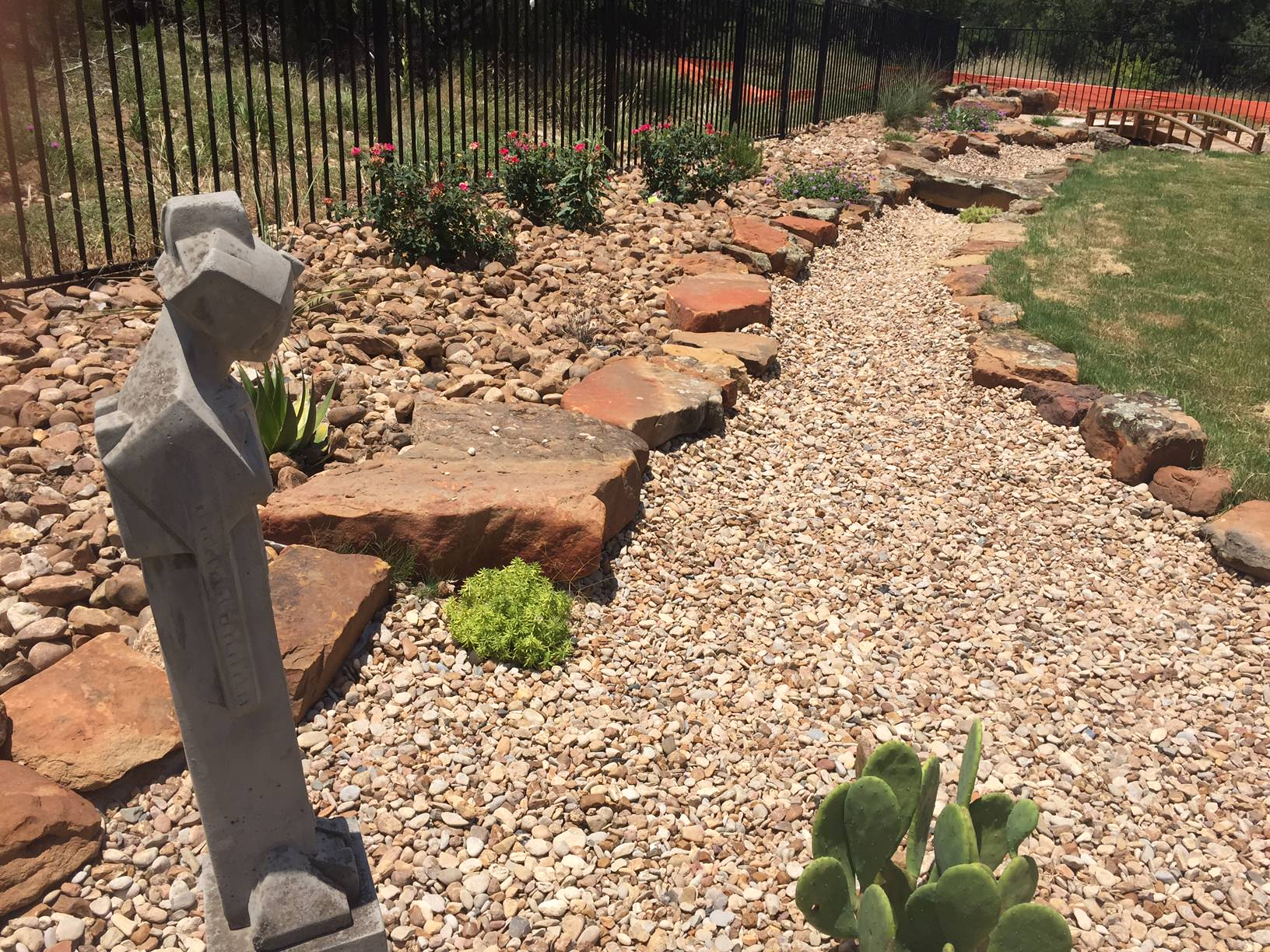 Xeriscape w/ dry creek bed for drainage