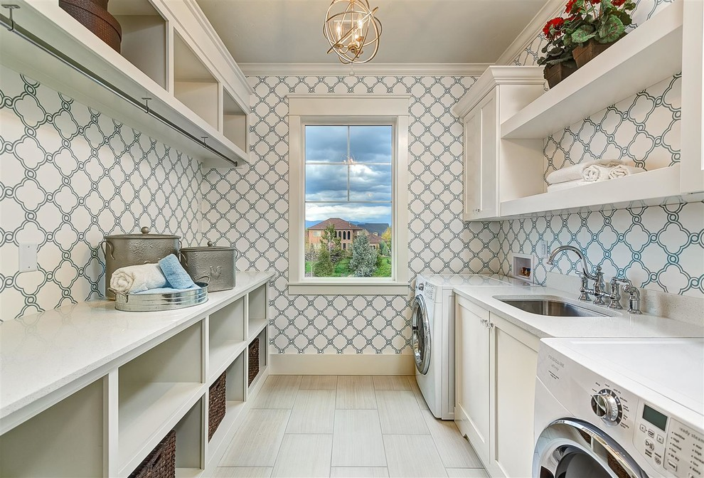 Inspiration for a large transitional galley porcelain tile and gray floor dedicated laundry room remodel in Boise with an undermount sink, shaker cabinets, white cabinets, multicolored walls, quartz countertops, a side-by-side washer/dryer and white countertops