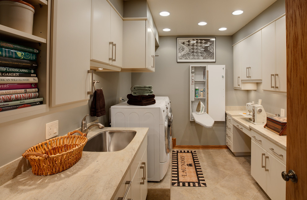 Inspiration for a contemporary laundry room remodel in Chicago with gray walls and white cabinets