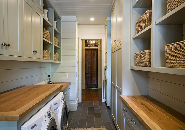 traditional laundry room by The Berry Group