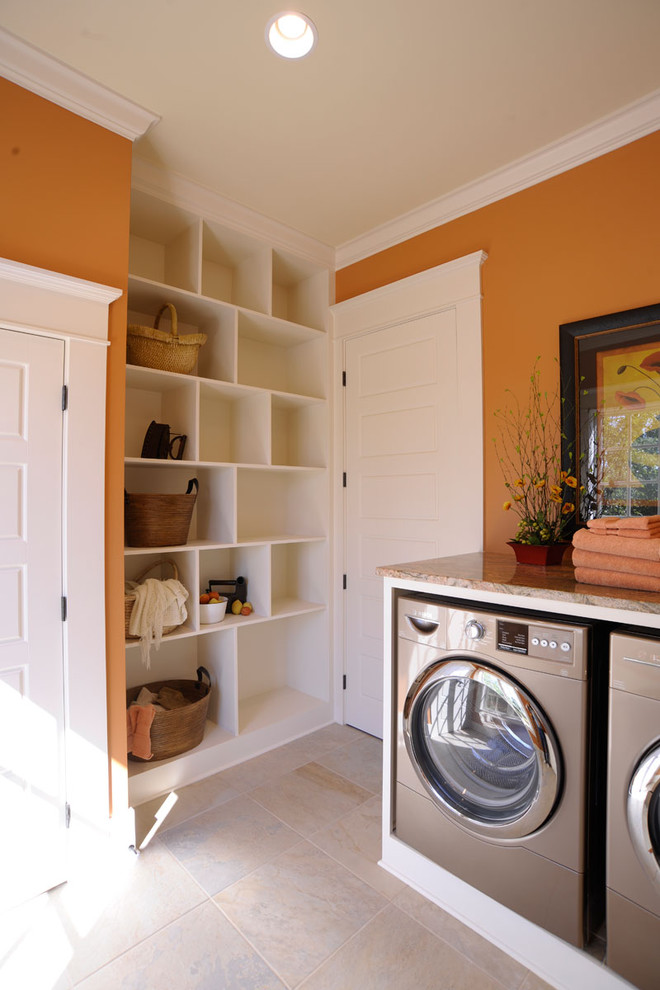 Inspiration for a timeless laundry room remodel in Cincinnati with orange walls