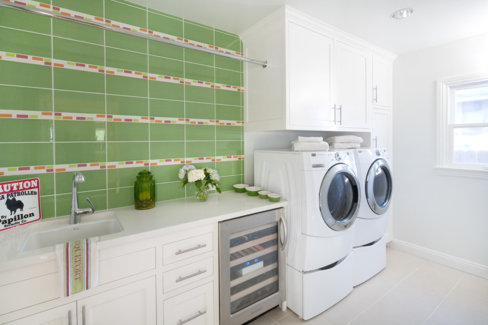 Dedicated laundry room - mid-sized transitional single-wall porcelain tile dedicated laundry room idea in Los Angeles with white cabinets, a side-by-side washer/dryer, shaker cabinets, a single-bowl sink and gray walls