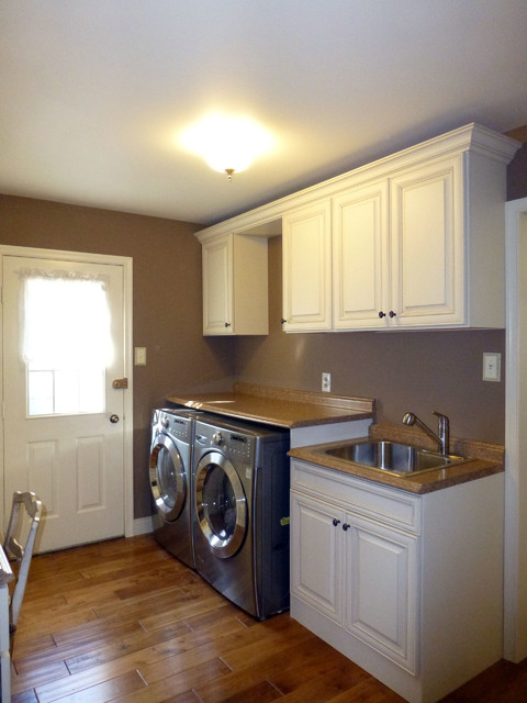 Ambler Kitchen in Haas Cabinets traditional laundry room