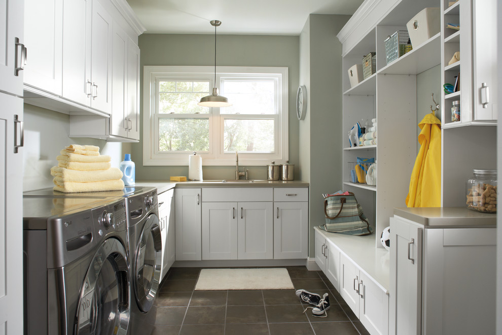 Large elegant u-shaped ceramic tile and gray floor dedicated laundry room photo in Indianapolis with an undermount sink, shaker cabinets, white cabinets, quartz countertops, a side-by-side washer/dryer and gray walls
