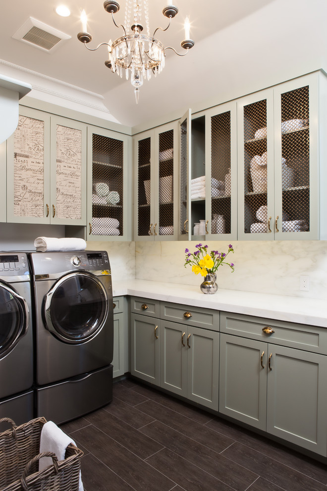 Example of a classic l-shaped brown floor laundry room design in San Francisco with shaker cabinets, green cabinets, a side-by-side washer/dryer and white countertops