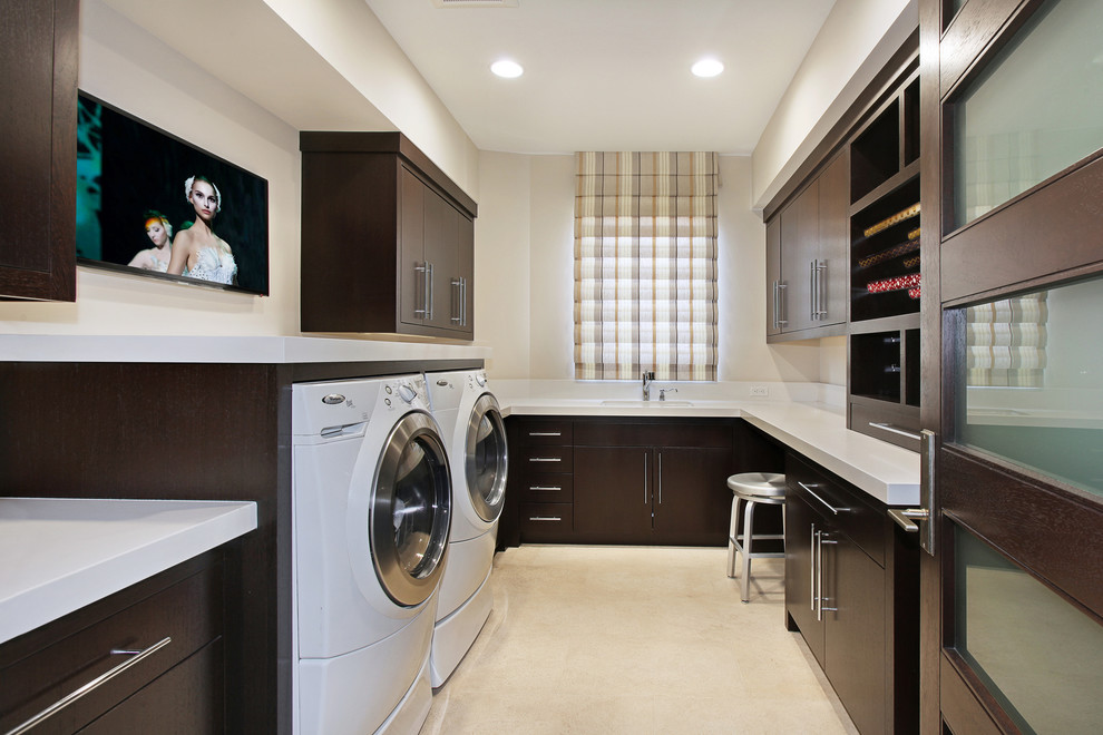 Laundry room - transitional laundry room idea in Orange County with dark wood cabinets and white countertops