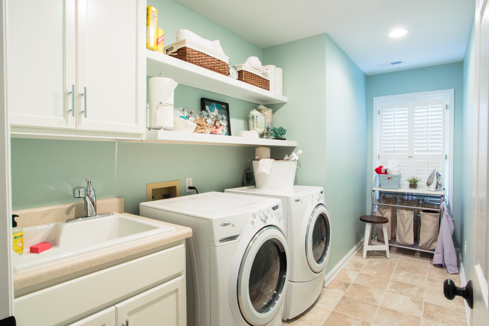 Example of a classic laundry room design in Other with blue walls