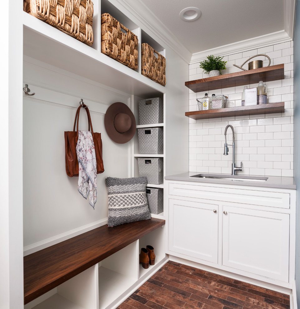 Utility room - small country single-wall brown floor and medium tone wood floor utility room idea in Seattle with an undermount sink, shaker cabinets, white cabinets, white walls, solid surface countertops and gray countertops